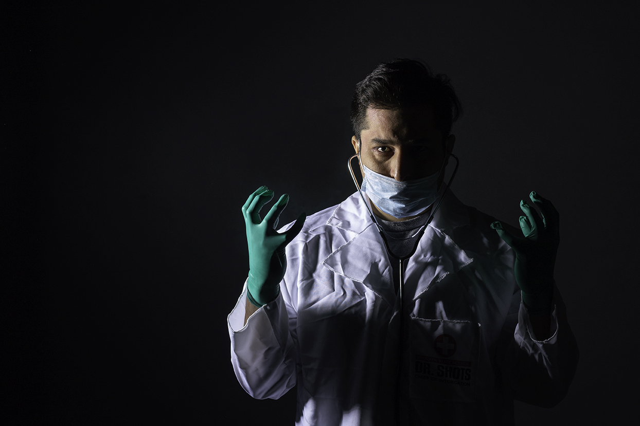 Man dressed as doctor, darkly posed