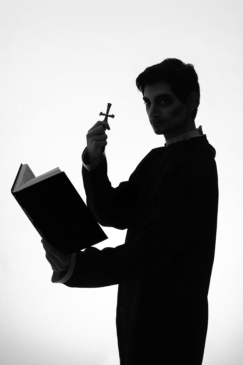 Man dressed as priest silhouette